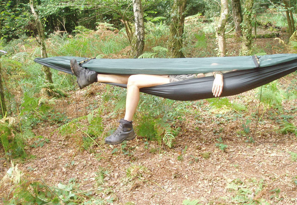 a man asleep in a hammock in the woods  wild bushcraft  pany   bushcraft weekend introduction course  rh   wildbushcraft co uk
